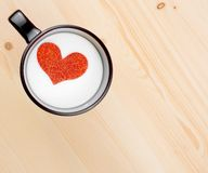 Top of view of cup of milk with decorative heart on wood table, concept of valentine day Royalty Free Stock Image