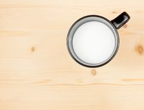Top of view of a cup of milk on wood table, concept of breakfast Stock Photo