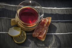 Mulled Wine. Top view of a cup of mulled red wine with sugared fruit and lemon slices royalty free stock photography