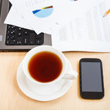 Top view cup of tea and office tools on table Royalty Free Stock Photos