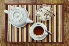 Top view of a cup of tea, teapot and sugar Royalty Free Stock Photography