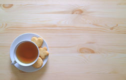 Top View of a Cup of Tea with Three Butter Cookies on the Wooden Table. Background Royalty Free Stock Photo