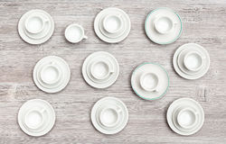 Top view of cups and saucers on gray brown table Royalty Free Stock Images