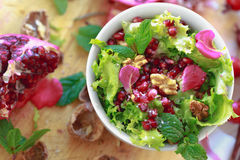 Top view of Curly endive salad with pomegranate, nuts... Royalty Free Stock Photo