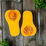 Top view Cut ripe orange pumkin with seeds on the rustic wooden table. Vegetarian, vegan, healthy diet food. Autumn harvest concep. T . Selective focus. Space stock photos