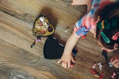 Baby girl playing with hair clips sitting in the floor Stock Image
