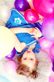 Top view of cute girl lying on big teddy bear Royalty Free Stock Photography