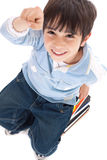 Top view of cute kid with fingers up Stock Photo