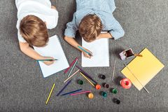 little boys drawing together stock image
