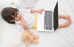 Top view of cute young girl using laptop Stock Photos