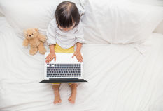 Top view of cute young girl using laptop Stock Images