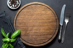 Top view of cutting board, silverware and spices Royalty Free Stock Photo