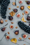 Top view of cutting Figs  and dark grapes, dry leaves, lavender, Royalty Free Stock Images