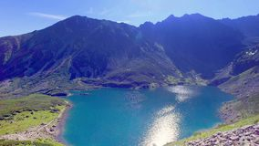 Top view of Czarny Staw Gasienicowy in summer, Tatra Mountains stock video footage