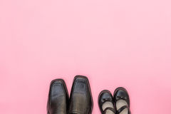 Top view daddy boots with daughter girl child on pink background Stock Image