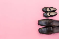 Top view daddy boots with daughter girl child on pink background Royalty Free Stock Image