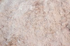 Top View of a Dark Ground Surface. Close Up Macro View of Dirt and Stones. Soil Background with Text Space Royalty Free Stock Photography