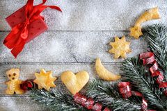 Decoration with cookies for Christmas and New Year on a wooden b Stock Photography