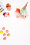 Top view of decorative flowers with macaroons and fruity cocktails. Isolated on white Stock Photo