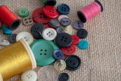 Top view of defocused golden thread spool stock photo