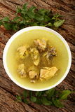 Top view-Delicious chicken broth with herbs and spices. Royalty Free Stock Images