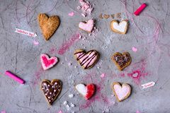 Delicious heart shaped cookies for valentines day on grey cracked surface. Top view of delicious heart shaped cookies for valentines day on grey cracked surface Royalty Free Stock Photos
