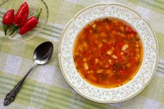 Top view of delicious homemade traditional bulgarian bean soup bob chorba with paprika, tomatoes, onion and spices, served with Stock Photos