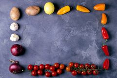 Top view of delicious ingredients for healthy cooking or salad making on slate vintage background. Bio Healthy food. Herbs and spices. Organic vegetables on Royalty Free Stock Photography