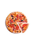Top view of delicious pizza with ham, tomatoes, and olives Royalty Free Stock Photo