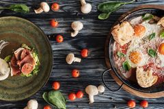 top view of delicious prosciutto, fried eggs and fresh vegetables stock photos