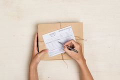 Top view of deliveryman making notes in Stock Photography