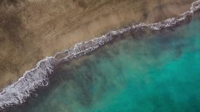 Top view of the desert beach on the Atlantic Ocean. Coast of the island of Tenerife. Aerial drone footage of sea waves stock video