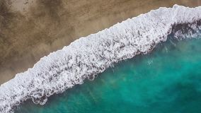 Top view of the desert beach on the Atlantic Ocean. Coast of the island of Tenerife. Aerial drone footage of sea waves stock video footage
