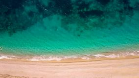 Top view of a deserted beach. Greek coast of the Ionian Sea. Aerial drone footage of sea waves reaching shore stock video footage