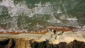 Top view of a deserted beach near the cliff. Greek coast of the Ionian Sea stock video footage