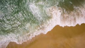 Top view of a deserted beach. The Portuguese coast of the Atlantic Ocean stock video
