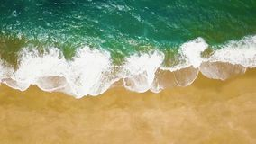 Top view of a deserted beach. The Portuguese coast of the Atlantic Ocean. Aerial drone footage of ocean waves reaching shore stock video