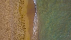 Top view of a deserted beach at sunset. Greek coast of the Ionian Sea stock footage