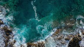 Top view of a deserted coast. Rocky shore of the island of Tenerife. Aerial drone footage of sea waves reaching shore stock video