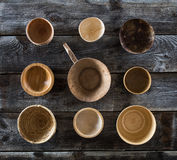 Top view, design collection of bowls set on genuine wood. Top view of design collection of many round wooden bowls set on genuine rustic old wood wallpaper for Royalty Free Stock Images