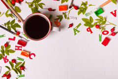 Top view of designer desktop with  coffee cup, flowers, pencil Royalty Free Stock Images