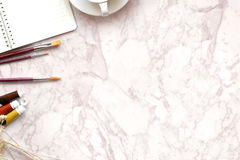 Top view designer or office workplace with copy space. White, marble table top view of the artist , Designer or creative. Hero header Concept Royalty Free Stock Images