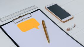 Top view of the designer`s workplace with smartphone, tablet, headphones and pen. Stock Image