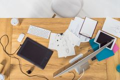 Top view of designer workplace with fashion illustrations and computer stock photography