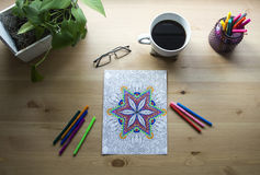 Top view of desk with coffee and art supplies Royalty Free Stock Image