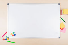 Top view of an desk top with whiteboard Royalty Free Stock Images