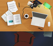 Top view of a desktop used as workplace. Top view of a desktop with a laptop, papers, lamp, pens, books, a cup of coffee, photos and a reflex Stock Photography