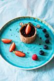 Top view of  dessert with chocolate and berries. Closeup of elegant dessert with chocolate, fresh berries and crispy bread Stock Image