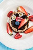 Top view of  dessert with tonka cream, chocolate and berries. Closeup of elegant dessert with tonka cream, chocolate, fresh berries and crispy bread Royalty Free Stock Photo