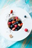 Top view of  dessert with tonka cream, chocolate and berries Royalty Free Stock Images